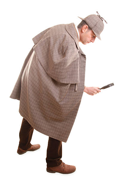 Detective Sherlock Holmes investigate with magnifying glass This detective is investigating with magnifying glass. sherlock holmes stock pictures, royalty-free photos & images