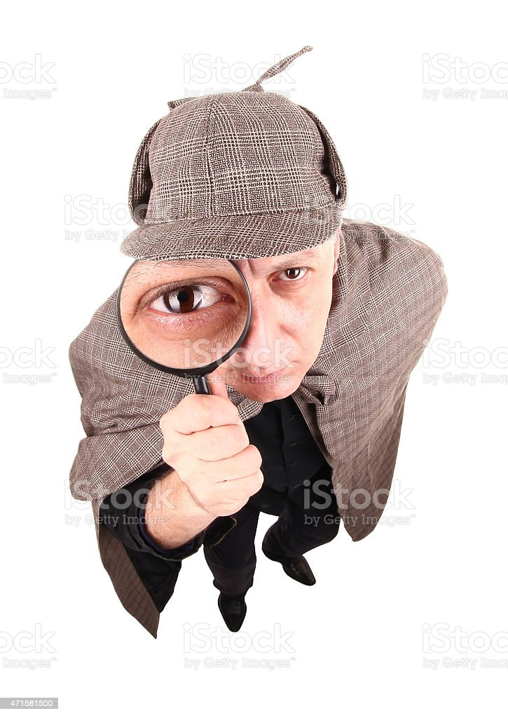 Detective Sherlock Holmes investigate with magnifying glass stock photo