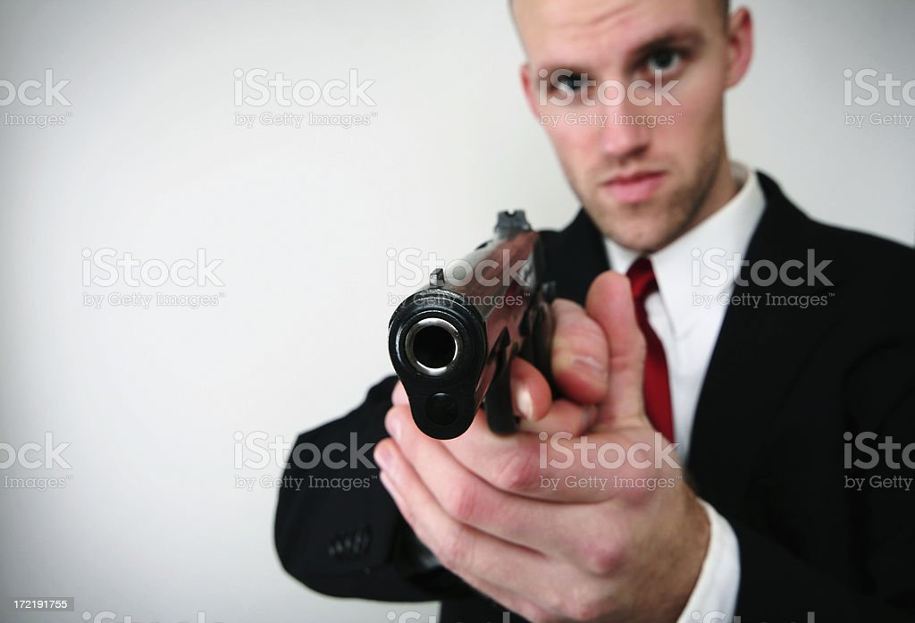 Detective / Spy With Gun and Copy Space royalty-free stock photo