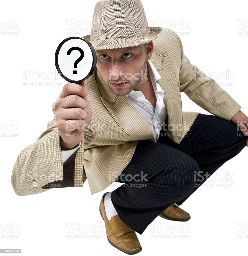 detective with magnifying glass royalty-free stock photo