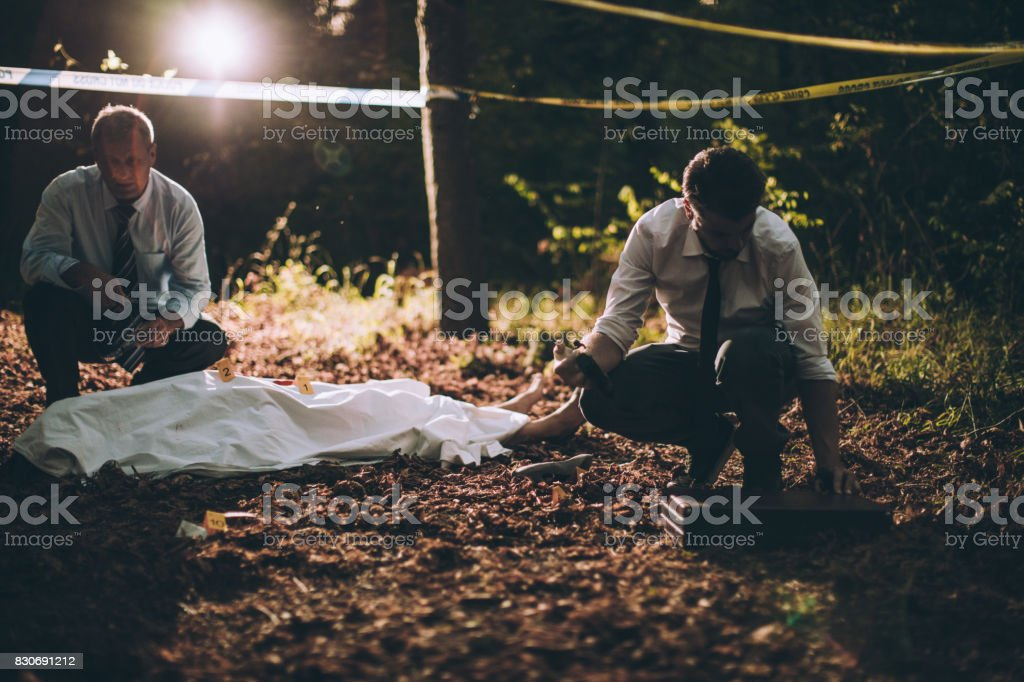 Detectives collecting evidence stock photo