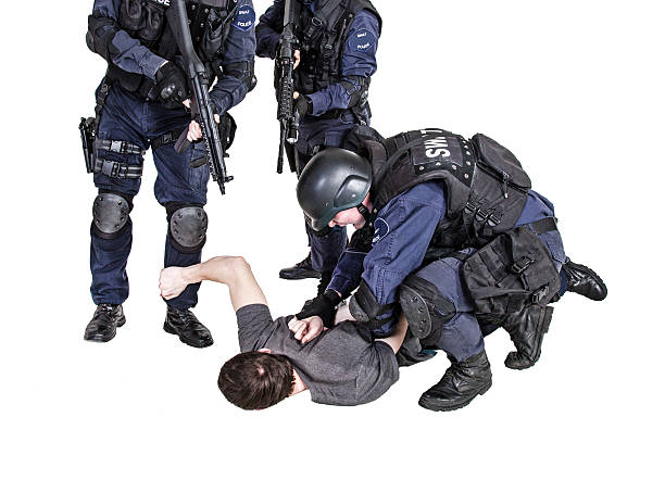 Detention Special weapons and tactics SWAT team makes a bust arrestment stock pictures, royalty-free photos & images