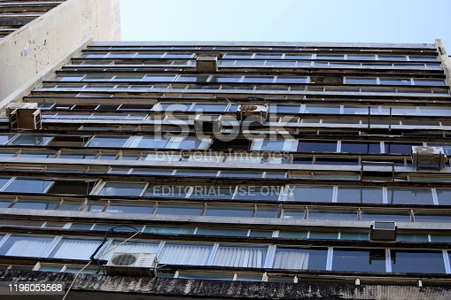 salvador, bahia / brazil - august 13, 2018: air conditioner with rusty brackets and risk of falling are seen installed in a commercial building on Ruy Barbosa Street in downtown Salvador.