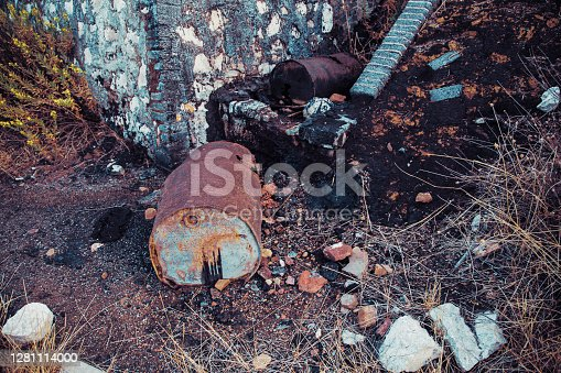 Deteriorated and abandoned tar spill drums in Peñarroya-Pueblonuevo, AL, Spain