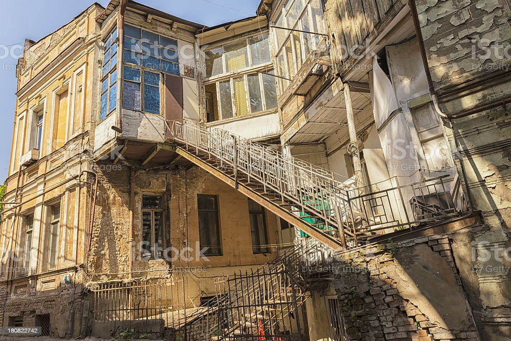 Deteriorating residential house in old part of Tbilisi royalty-free stock photo