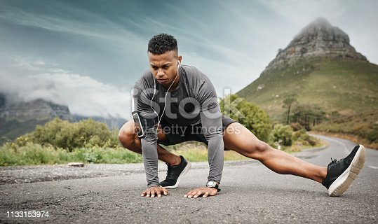 Shot of a sporty young man exercising outdoors