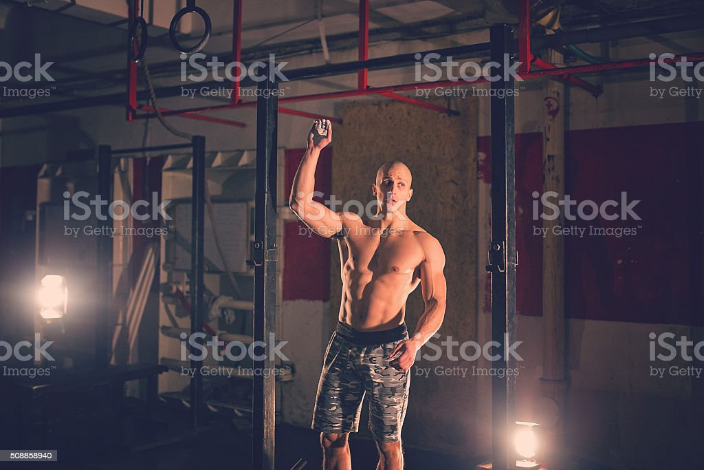 Bodybuilder at the health club getting ready to exercise