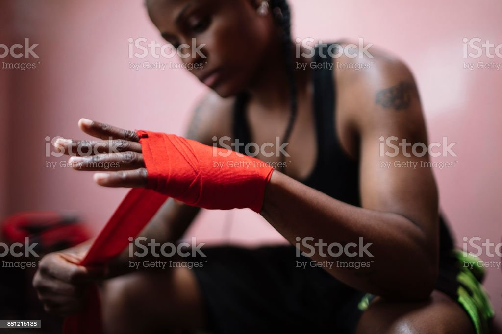 Young woman fixing her sports equipment before training