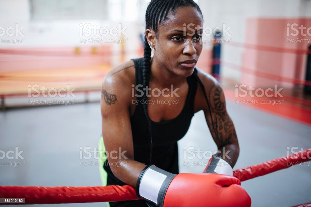 Woman concentrating in the boxing ring before her match