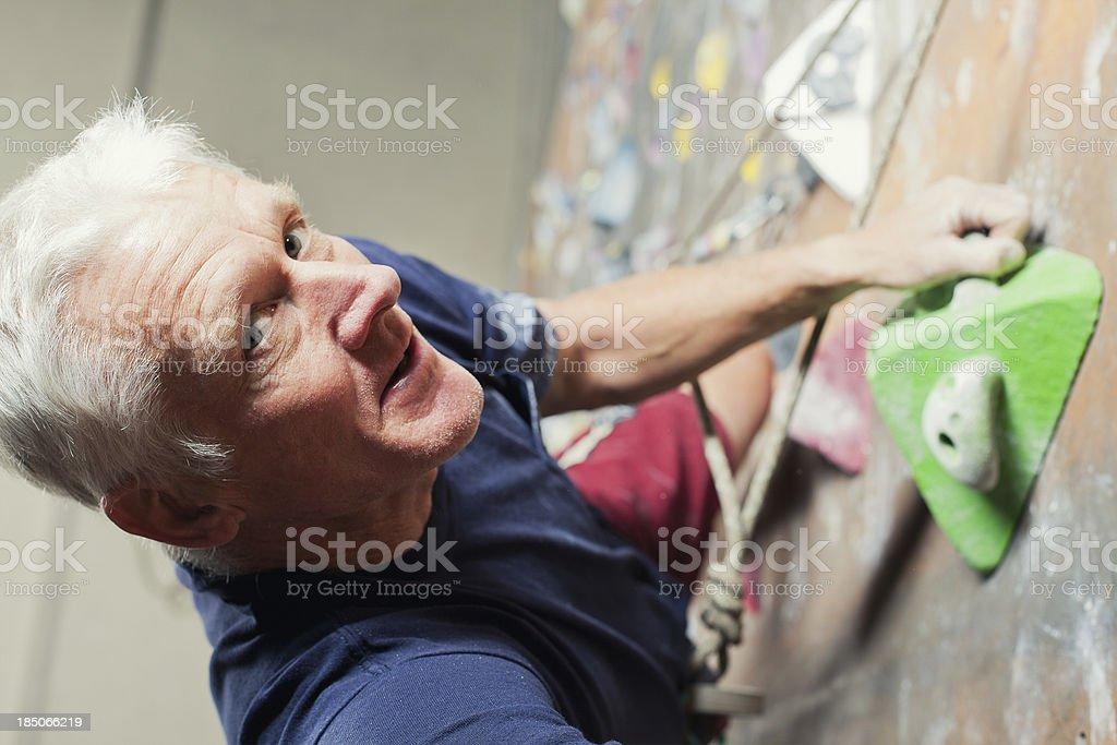 Determination - Senior Rock Climber royalty-free stock photo