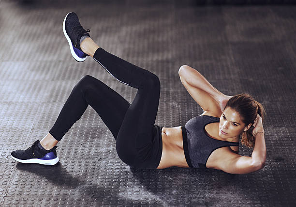 determination today, success tomorrow - sit ups stock photos and pictures