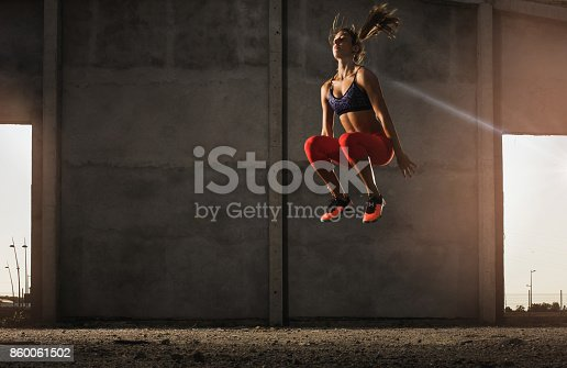 istock Determined athlete exercising high jumps in an old ruin. 860061502