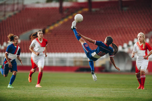Determined bicycle kick on a soccer match! stock photo