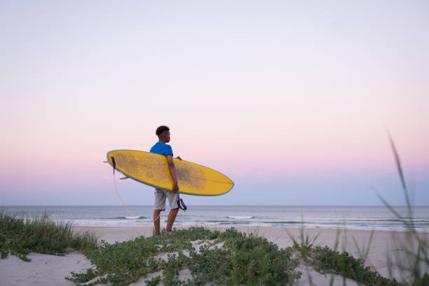 Determined for a surf today stock photo
