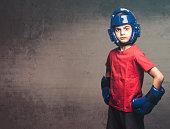 Young boxer posing with an attitude. Martial arts concept