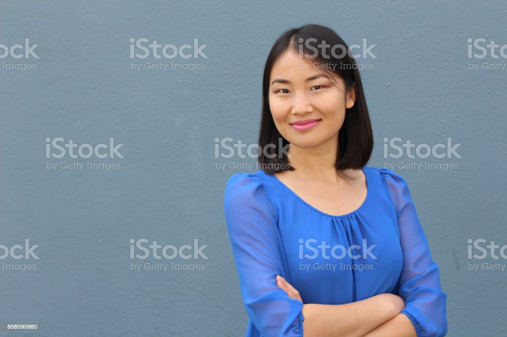 Determined looking Asian working woman stock photo