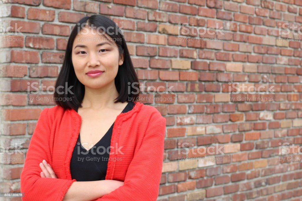 Determined looking Asian working woman with copyspace stock photo
