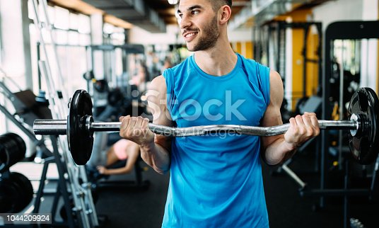 istock Determined male working out in gym 1044209924