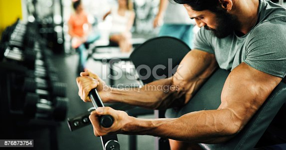 istock Determined male working out in gym 876873754