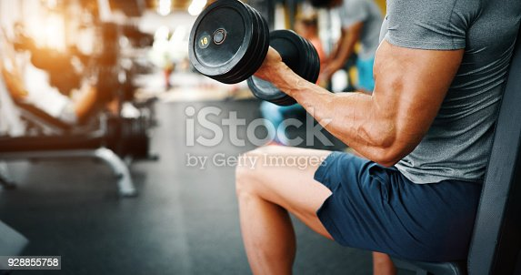 istock Determined male working out in gym 928855758