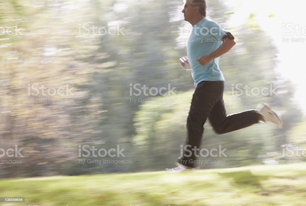 Determined man running outdoors royalty-free stock photo