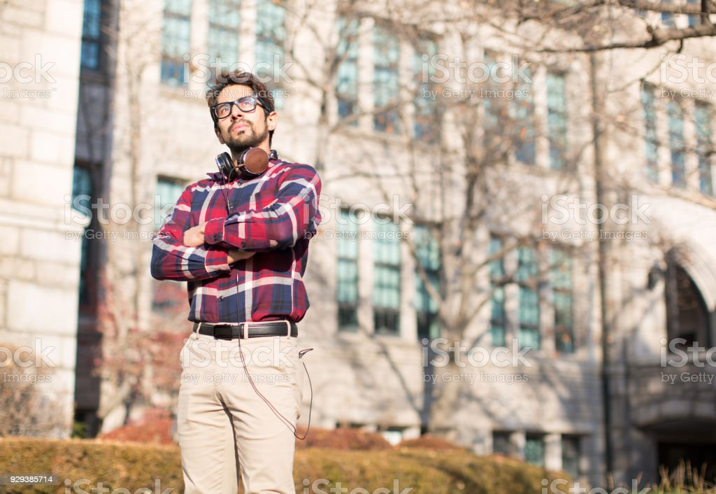 Determined Man with Arms Crossed in Front of Nice Building. Businessman stock photo