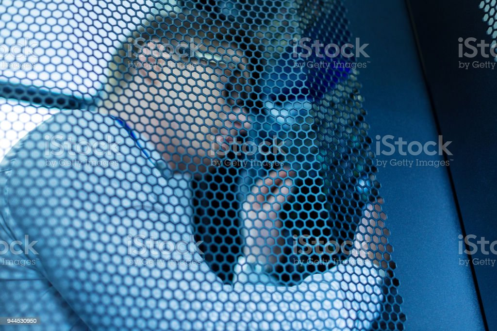 Determined operator working in a data center stock photo