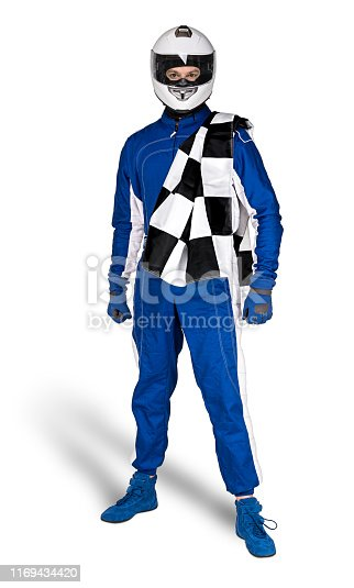 Determined race driver in blue white motorsport overall shoes gloves integral safety crash helmet and chequered checkered flag isolated on white background. Car racing motorcycle sport concept.