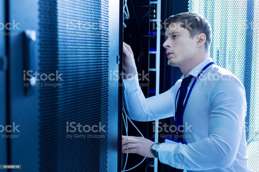 Determined skillful operator repairing wires stock photo