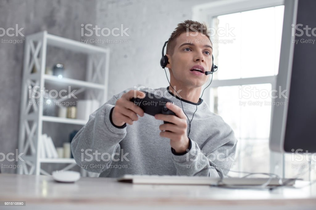 Determined teenager playing a computer game stock photo