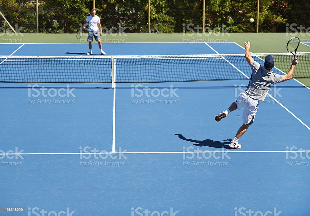 Determined to return that serve stock photo