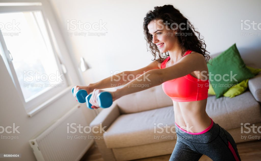 Determined Woman Losing Weight At Home And Exercising With