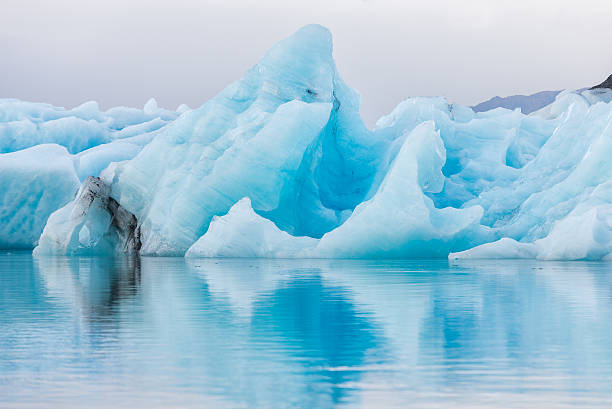 Detial view of iceberg in ice lagoon - Jokulsarlon, Iceland. Detial view of iceberg in ice lagoon - Jokulsarlon, Iceland. glacier lagoon stock pictures, royalty-free photos & images