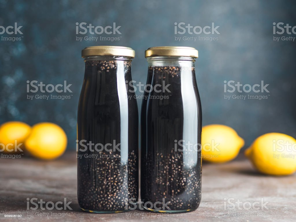 Detox activated charcoal black chia lemon water stock photo