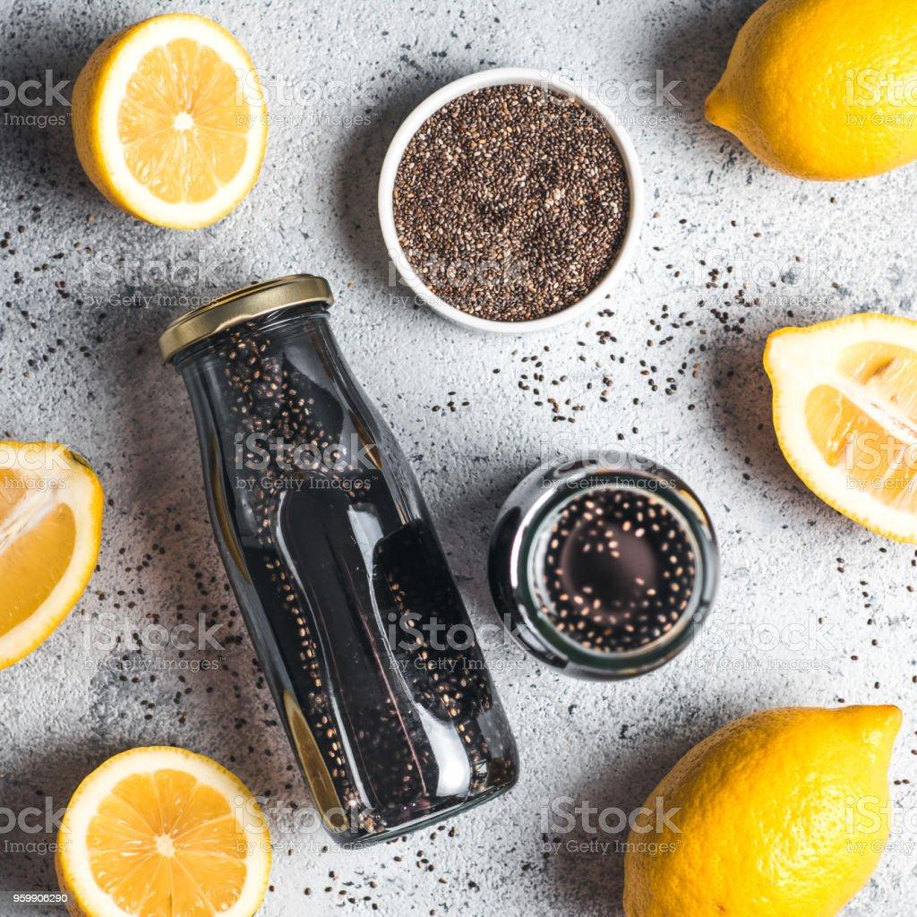 Detox activated charcoal black chia lemon water stock photo