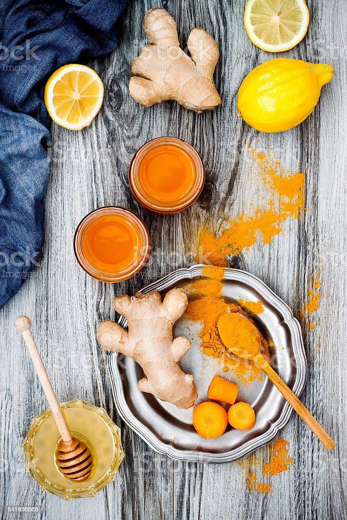 Detox carrot ginger turmeric immune boosting, anti inflammatory smoothie stock photo