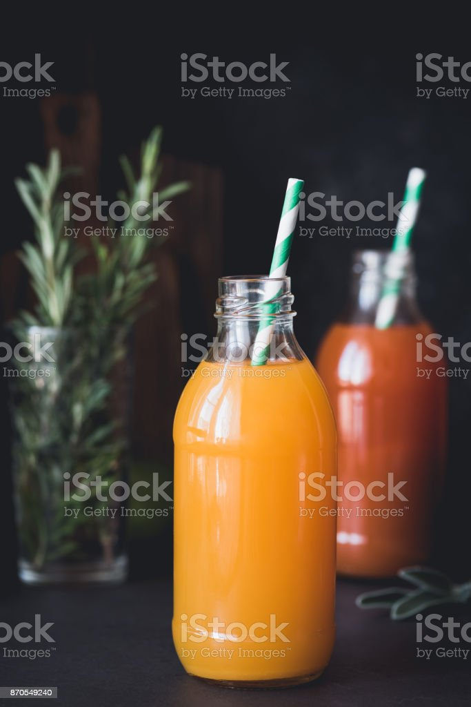 Detox citrus juices in bottle. Fresh grapefruit and orange juice in bottle stock photo