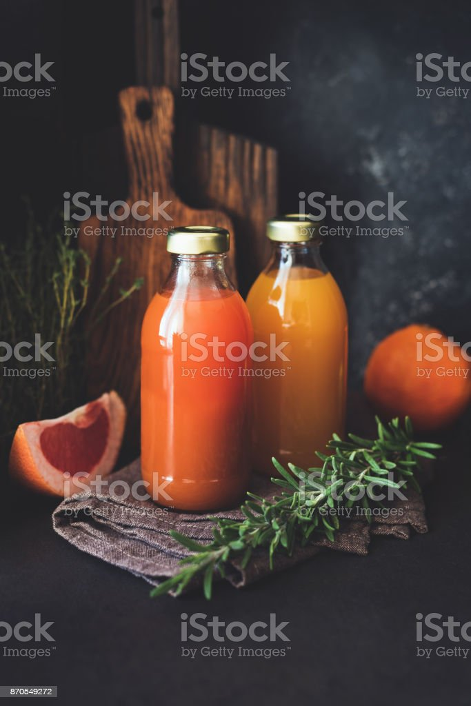 Detox citrus juices in bottle. Fresh grapefruit and orange juice stock photo