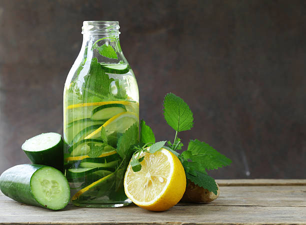 detox drink with fresh cucumber, lemon and ginger - cucumber stock photos and pictures