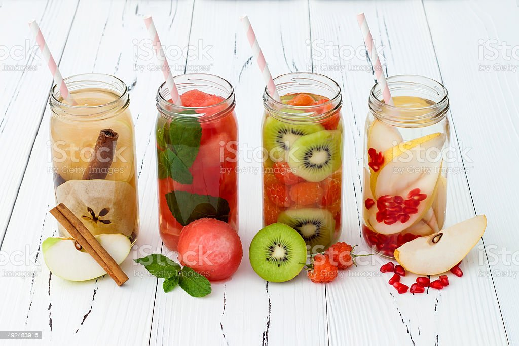 Detox fruit infused flavored water. Refreshing summer homemade cocktail royalty-free stock photo