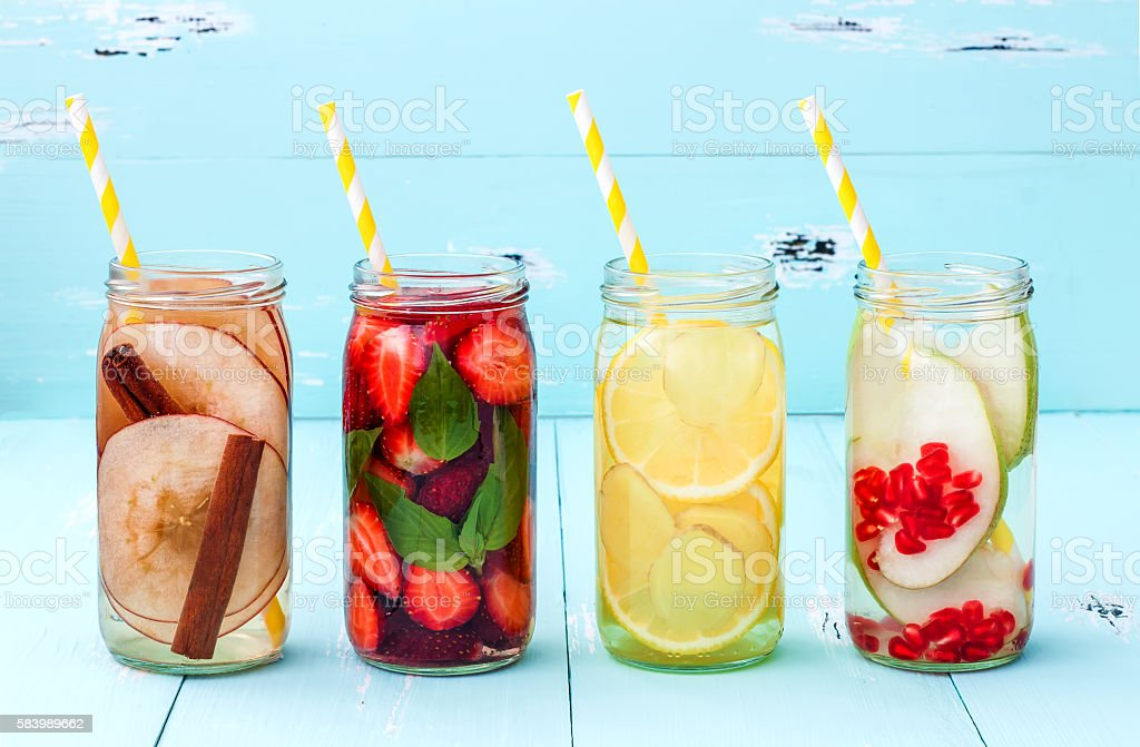 Detox fruit infused flavored water. Refreshing summer homemade cocktail. stock photo