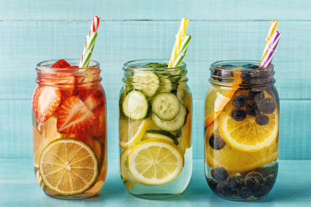 Detox fruit infused water. Detox fruit infused water. Refreshing summer homemade cocktail, selective focus. infused stock pictures, royalty-free photos & images
