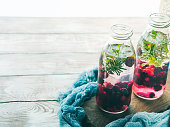 Detox infused water with berries and rosemary