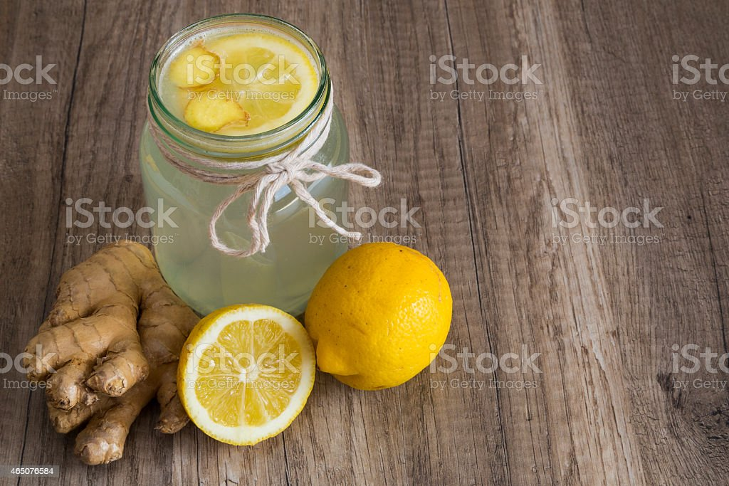 Detox Lemon And Ginger Drink In A Jar Stock Photo - Download