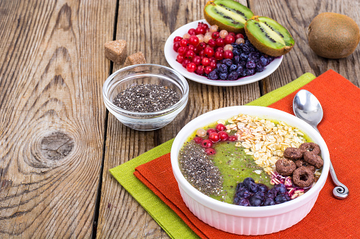 840939766 istock photo Detox menu with fresh fruit, chia seeds and cereal for breakfast. Healthy food 924139070