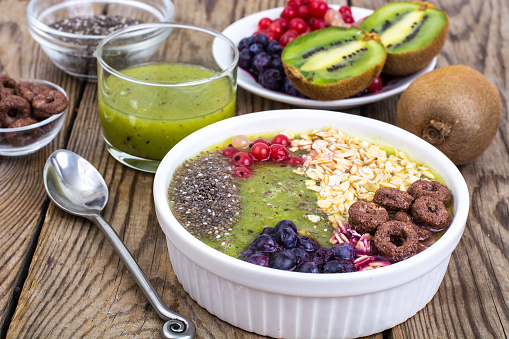 840939766 istock photo Detox menu with fresh fruit, chia seeds and cereal for breakfast. Healthy food 924139112