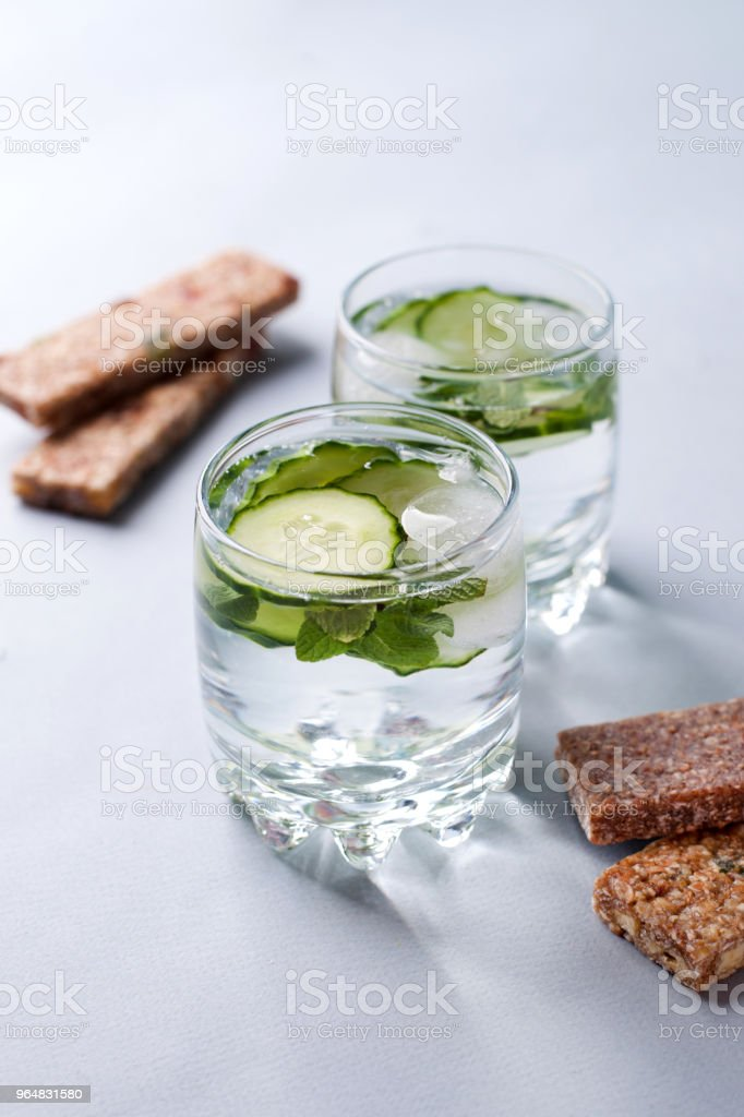 Detox water infused with sliced cucumber and springs of mint, copy space royalty-free stock photo