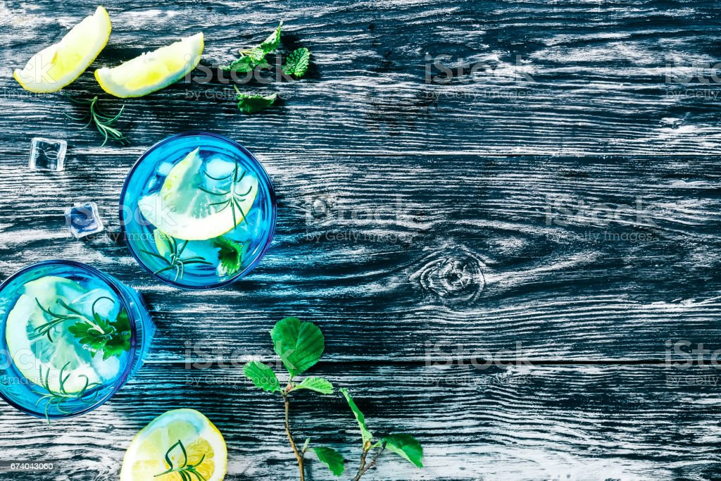 Detox water with lemon and rosemary royalty-free stock photo