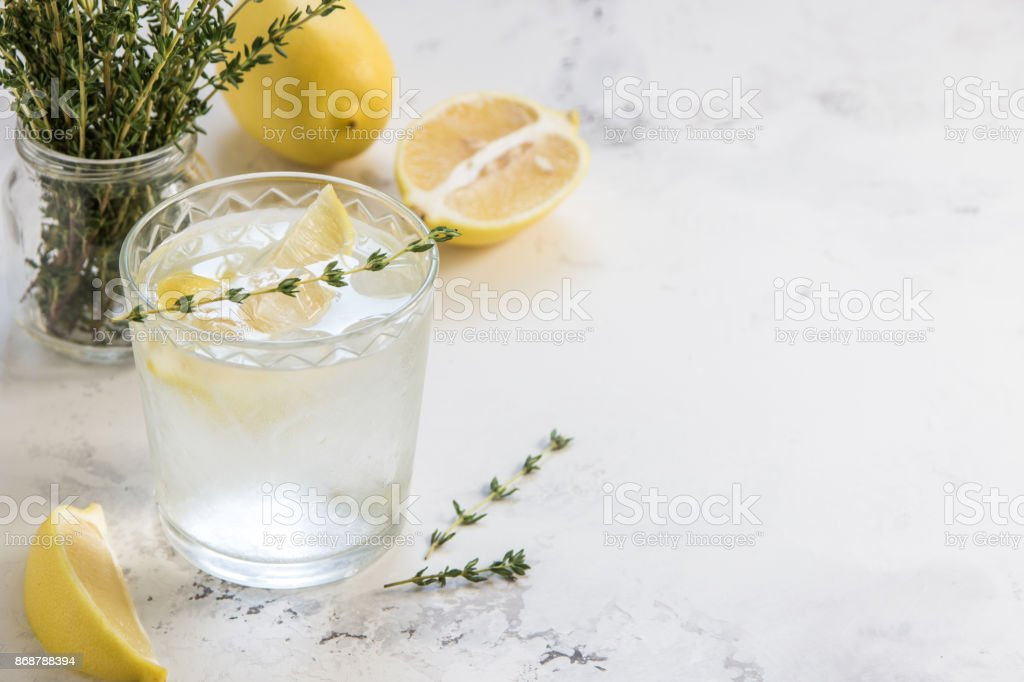 Detox water with lemon and thyme in glass, copy space stock photo