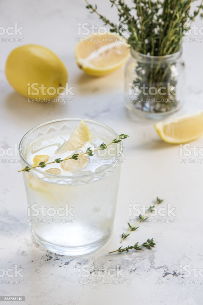 Detox water with lemon and thyme in glass stock photo